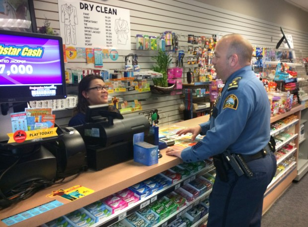 St. Paul Police Chief Todd Axtell stopped into the Aidan Convenience Store in the Securian Building's skyway level in downtown St. Paul and talked to owner Amphone Ho on Tuesday, May 23, 2017. (Mara H. Gottfried / Pioneer Press)