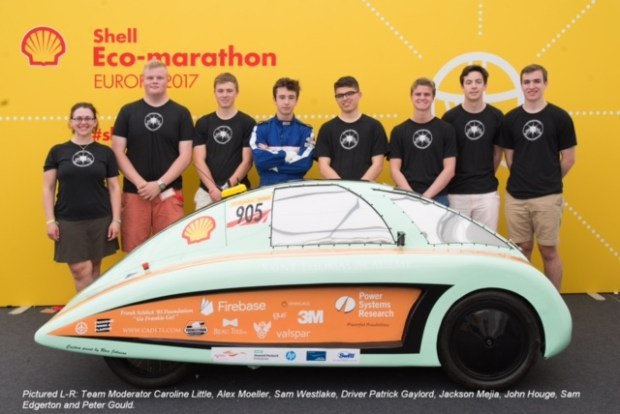 Saint Thomas Academy Experimental Vehicle Team Alpha members pose for a portrait at Shell Make the Future Live on May 24, 2017, in London. From left: Team moderator Caroline Little, Alex Moeller, Sam Westlake, driver Patrick Gaylord, Jackson Mejia, John Houge, Sam Edgerton and Peter Gould. (Courtesy of Stuart Conway/Shell)