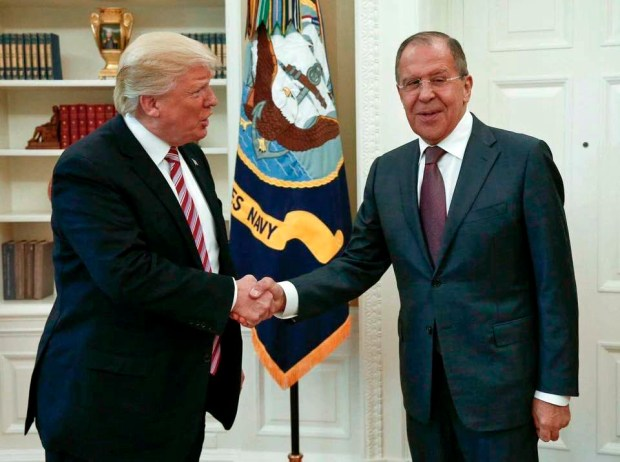 US President Donald Trump shakes hands with Russian Foreign Minister Sergey Lavrov in the White House in Washington, Wednesday, May 10, 2017. President Donald Trump on Wednesday welcomed Vladimir Putin's top diplomat to the White House for Trump's highest level face-to-face contact with a Russian government official since he took office in January. (Russian Foreign Ministry Photo via AP)