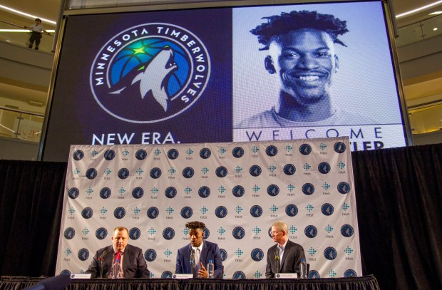 Minnesota Timberwolves new point guard Jimmy Butler, center, is joined by Timberwolves head coach Tom Thibodeau, left, and General Manager Scott Layden during a press conference at Mall of America in Bloomington, Minn., on Thursday, June 29, 2017.(AP Photo/Andy Clayton-King)