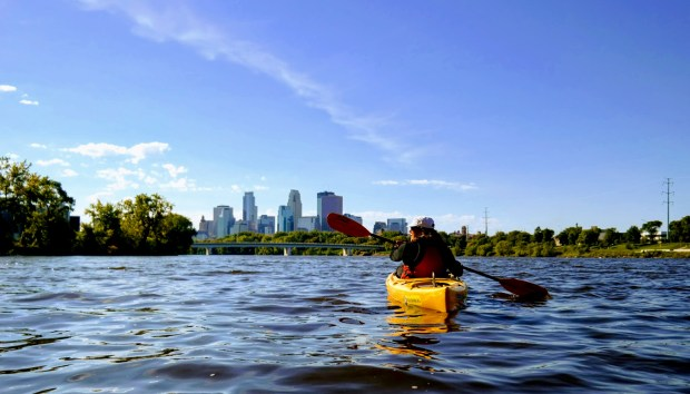 A paddler kayaks the Mississippi River in Minneapolis in May 2017 using a boat rented from Paddle Share, a National Park Service-led program featuring self-serve kayak rentals. The program began in Minneapolis in 2016 and is slated to expand into St. Paul in late July 2017. (Courtesy of Ashley Gillingham)
