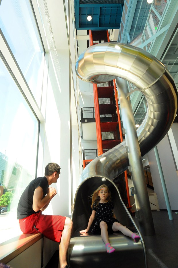 "Nora Stewart slides down The Scramble, one of 10 new exhibits at the Minnesota Children's Museum on Tuesday, June 7, 2017. Stewart, of Shoreview, was celebrating her seventh birthday and got out of school early as a surprise present. ""It was scary the first time, but the second time it was kind of normal,"" she said of the slide. The museum officially opens Wednesday. (Ginger Pinson / Pioneer Press)"