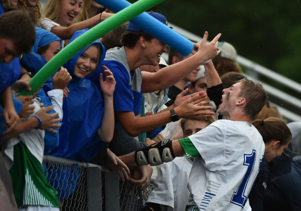 Eagan Wildcats midfielder Joseph Hofmann shouts for joy as he leaps into he crowd following the Wildcats 19-12 victory over the Benilde St. Margarat's School Red Knights in the Minnesota State High School League Boys Lacrosse Championship game at Chanhassen High School on Saturday. June 17, 2017.(John Autey / Special to the Pioneer Press)
