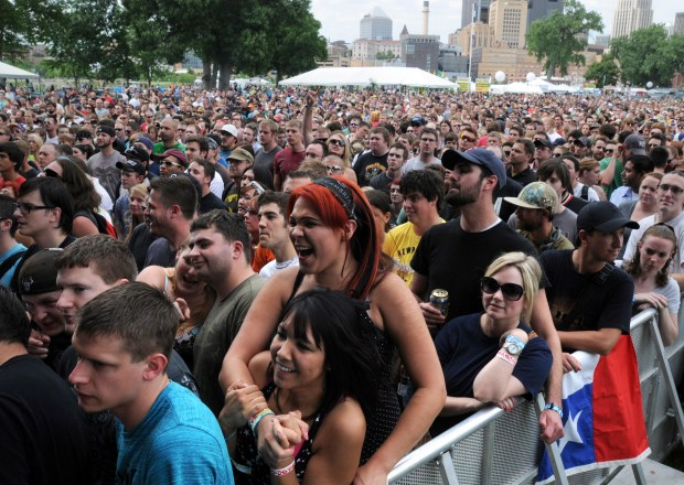 Music fans listen to the band Coheed And Cambria at the inaugural River's Edge Music Festival on Harriet Island in St. Paul, Saturday, June 23, 2012. (Pioneer Press: Chris Polydoroff)