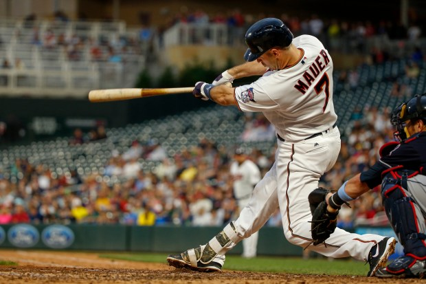 Minnesota Twins Joe Mauer hits an RBI double against the Cleveland Indians in the third inning of the second baseball game of a doubleheader Saturday, June 17, 2017, in Minneapolis. (AP Photo/Bruce Kluckhohn)