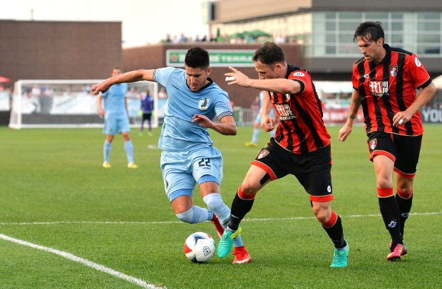 Minnesota United FC defender Kevin Venegas works the ball against AFC Bournemouth midfielder Marc Pugh in the first half of the a Minnesota United FC Friendly Game against AFC Bournemouth from the English Premier League at the National Sports Center stadium in Blaine on Wednesday, July 20, 2016. (Pioneer Press: John Autey)