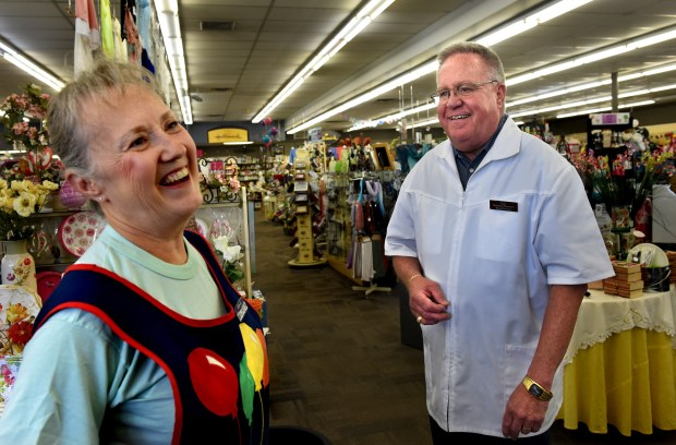 Maureen Pommier, gift department manager and buyer who has been with Setzer Pharmacy for 36 years, laughs with owner Gary Raines, 71, who will be leaving Setzer's Pharmacy and Gift Center on Rice Street in St. Paul Friday, June 30, 2017. (Jean Pieri / Pioneer Press)