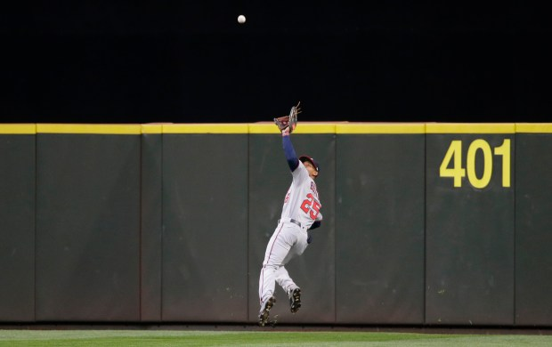 Minnesota Twins center fielder Byron Buxton makes a leaping catch of a line drive hit by Seattle Mariners' Robinson Cano during the fifth inning of a baseball game, Thursday, June 8, 2017, in Seattle. (AP Photo/Ted S. Warren)