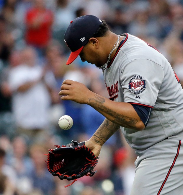 Minnesota Twins starting pitcher Adalberto Mejia gets a new ball after giving up a home run to Seattle Mariners' Carlos Ruiz during the third inning of a baseball game Wednesday, June 7, 2017, in Seattle. (AP Photo/Elaine Thompson)