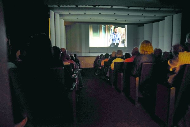"People watch ""Warehoused"" on June 20, at the Willmar Education and Arts Center in Willmar. The documentary about refugees was screened at the WEAC auditorium on World Refugee Day. (Briana Sanchez / Forum News Service)"