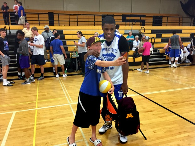 Incoming Gophers freshman basketball player Isaiah Washington poses for a selfie with Zach Moonan, an 11-year-old fan, at the Twin Cities Pro-Am at DeLaSalle High School in Minneapolis on Tuesday, June 27, 2017. (Chad Graff / Pioneer Press)