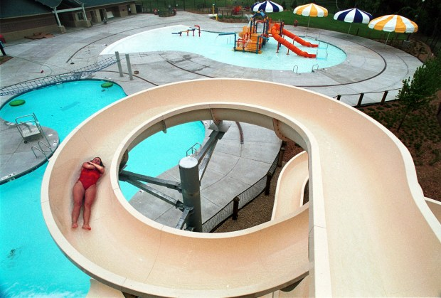 Lifeguard Erin Roth checks out the slide at the Battle Creek Waterworks as the waterpark is readied to open in May 2000. (Joe Oden / Pioneer Press)