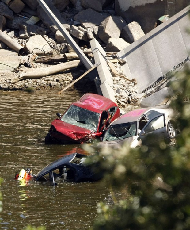 A diver searches through cars amidst the rubble of the collapsed Interstate 35W bridge in Minneapolis, Friday, Aug. 3, 2007. (Associated Press / Gerald Herbert)