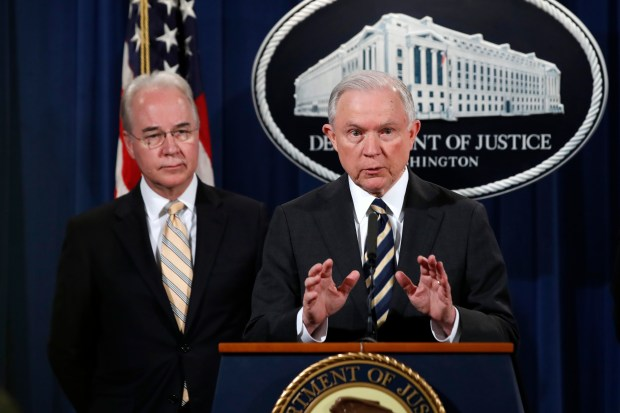 Attorney General Jeff Sessions, right, with Health and Human Services Secretary Tom Price, speaks about opioid addiction during a news conference, Thursday, July 13, 2017, at the Justice Department in Washington. (AP Photo/Jacquelyn Martin)