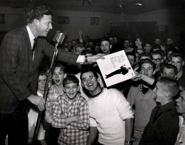 Former St. Paul Pioneer Press columnist and media personality Bill Diehl is shown at a sock hop in Hersey, Wis. in a file photo from Feb. 1962. (Pioneer Press Files)