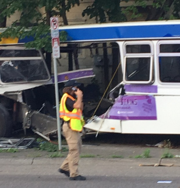 A Metro Transit bus gapes open after a fatal collision at the intersection of Dale Street and Charles Avenue in St. Paul. (Courtesy of Bonnie Willson)
