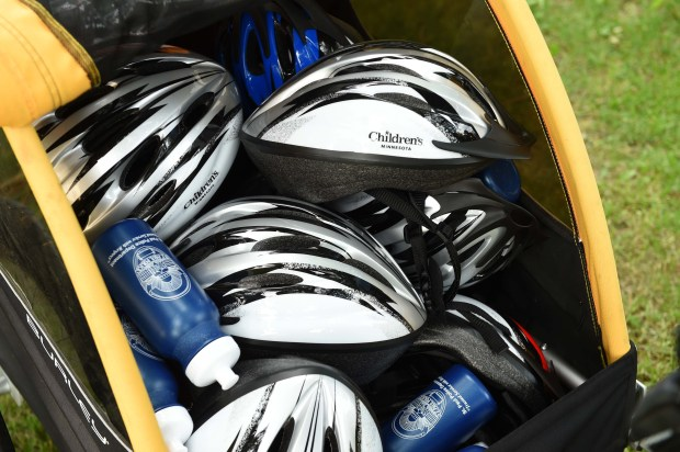 St. Paul Police Officer Jason Bain pulls a trailer full of bike helmets to give away to kids, part of a new program called Bike Cops for Kids, at St. Paul's Conway Rec Center on June 29, 2017. Modeled after a program in Minneapolis, officers give bike helmets to children they encounter and teach them about bike safety. (Scott Takushi / Pioneer Press)