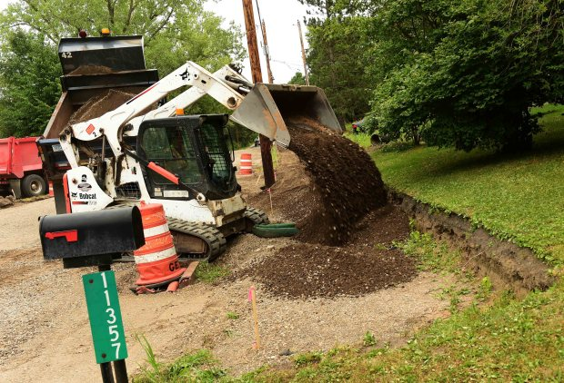 Lake Elmo residents Tim and Diana Danielson are not happy that their city is tearing out the new streets and sidewalks that were installed only a few months ago and reinstalling them 15 inches higher, July 13, 2017. A bobcat is used to drop dirt and gravel to raise the level of the sidewalk in front of the Danielson's yard. The Danielsons wants the city to build a retaining wall along the sidewalk fronting his yard, instead the city opted to re-build 400 feet of the brand new street and sidewalks. (Scott Takushi / Pioneer Press)