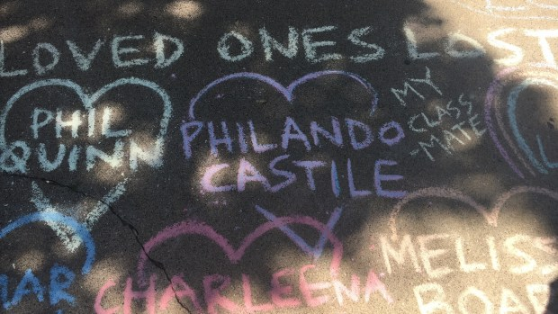 Shade from tree-lined 51st Avenue dapples the site where people wrote the names of those killed by police -- including Phil Quinn and Philando Castile, both of St. Paul -- for a tribute to Justine Damond, who was shot and killed by police died late Saturday night after calling 911 about a possible assault.