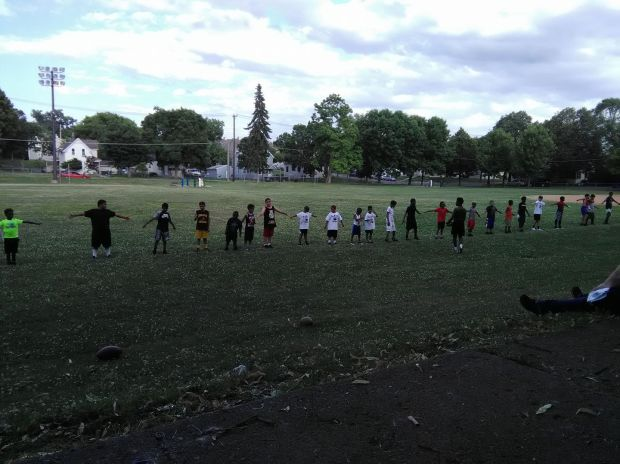 Youth in Lower East St. Paul participate in a football camp in July, 2017. A community member is only about $500 short of her goal to raise $3,400 for new helmets. Without the helmets, the youth might not be allowed to compete during the season. (Courtesy Photo / LeeAnn Larson)