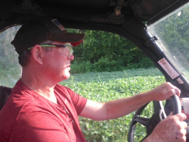 Vikings coach Mike Zimmer drives around his Kentucky property wearing protective goggles on July 17, 2017.