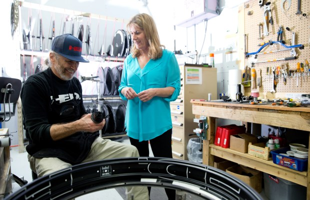 Undated courtesy photo, circa July 2017, of Anne Hed, right, with employee John S. in the wheel repair department of Hed Cycling in Roseville. Anne, who started the company with her late husband, Steve, in 1984, has been running Hed Cycling as the sole owner since Steve's sudden death in 2014. The company started with bike wheels and for the past few years, Hed Cycling has been making bike frames, too. You won't see any of Hed Cycling's frames in the Tour de France -- they're primarily for triathletes -- but you will see their wheels. Four teams, comprised of nine cyclists, are using Hed Cycling wheels in this year's Tour de France time trials. (Courtesy of Brian Ach / Hed Cycling)