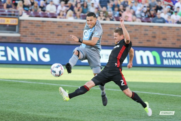 Minnesota United's Christian Ramirez gets past D.C. United defender Taylor Kemp and shoots for the Loons' first goal Saturday, July 29, 2017, in a 4-0 victory at TCF Bank Stadium. (Courtesy Minnesota United)