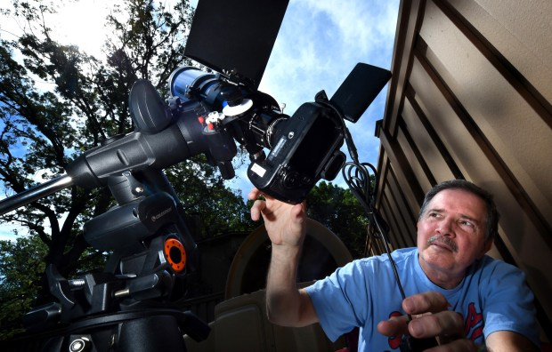 Mark Connolly photographs the sun through a specialized filter with a 480 mm telescope on a modified Canon 60D camera body in Roseville, Wednesday, June 21, 2017. Connolly will be taking this gear with him when he goes to Missouri with his wife and three grandchildren to see the eclipse August 21. (Jean Pieri / Pioneer Press)
