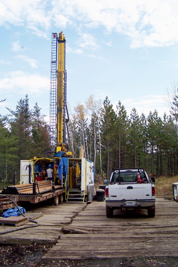 In this Oct. 4, 2011,file photo, a prospecting drill rig bores into the bedrock near Ely, Minn., in search of copper, nickel and precious metals that Twin Metals Minnesota LLC, hopes to mine near the Boundary Waters Canoe Area Wilderness in northeastern Minnesota. (Steve Karnowski, Associated Press)