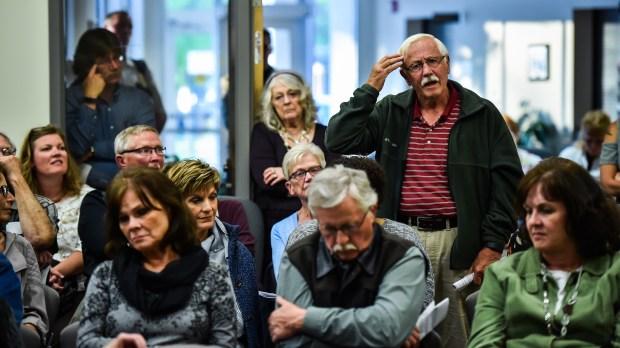 Larry Olson, 74, of Granite Falls, Minn., asks Dr. Ayaz Virji a question during his lecture on Islam at the Granite Falls, Minn., City Hall. (Salwan Georges, Washington Post)