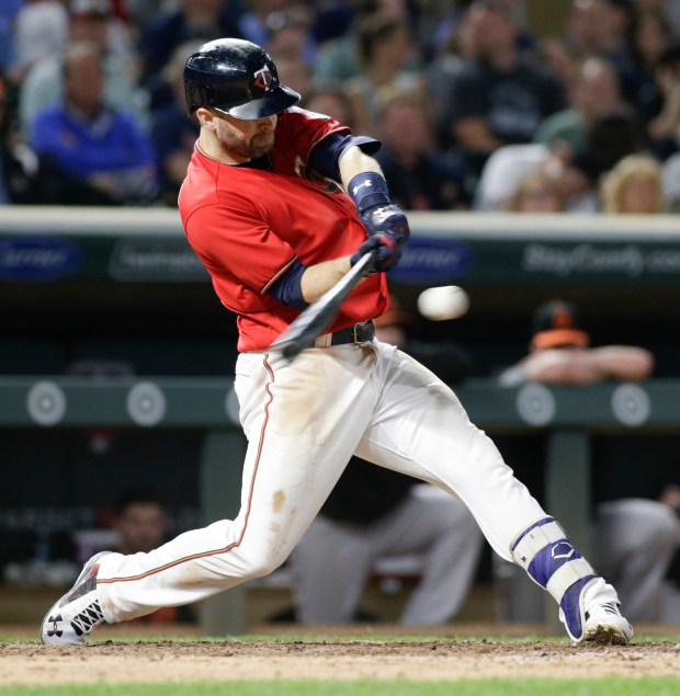 Minnesota Twins' Brian Dozier hits an RBI single during the eighth inning against the Baltimore Orioles in a baseball game, Friday, July 7, 2017, in Minneapolis. Minnesota won 9-6. (AP Photo/Paul Battaglia)
