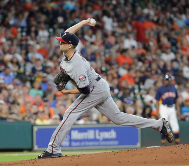 Minnesota Twins' Kyle Gibson throws against the Houston Astros during the first inning of a baseball game, Sunday, July 16, 2017, in Houston. (AP Photo/David J. Phillip)