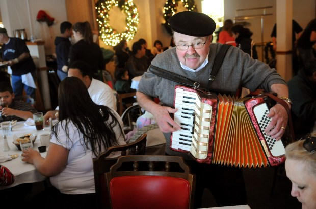 """""""I like to make people feel important,"""" said George Schlitz, a professional according player who volunteered to perform during the free Thanksgiving meal served at Casper's Cherokee Sirloin Room in West St. Paul, Minn., on Thursday, November 26, 2009. """"This is what is about.""""(Pioneer Press: Ben Garvin)"""
