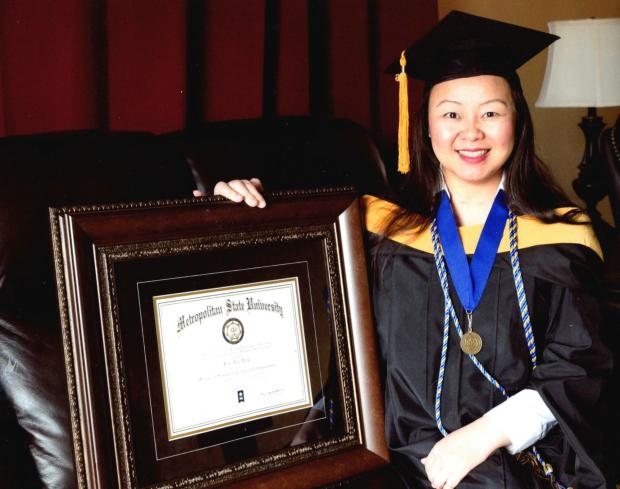 Kari Yang of Woodbury, Minn., displays the diploma representing the master's degree she earned after receiving a kidney donated by Jane Pasley who died in August 2013. (Submitted photo)