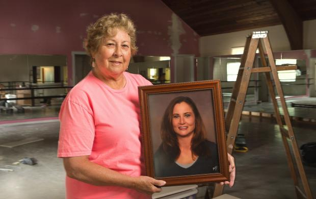 Nancy Pasley holds a portrait of her daughter, Jane, who died unexpectedly four years ago and, through the gift of organ donation, benefitted more than 30 people, including a Woodbury kidney recipient. (Eric Hylden / Grand Forks Herald)