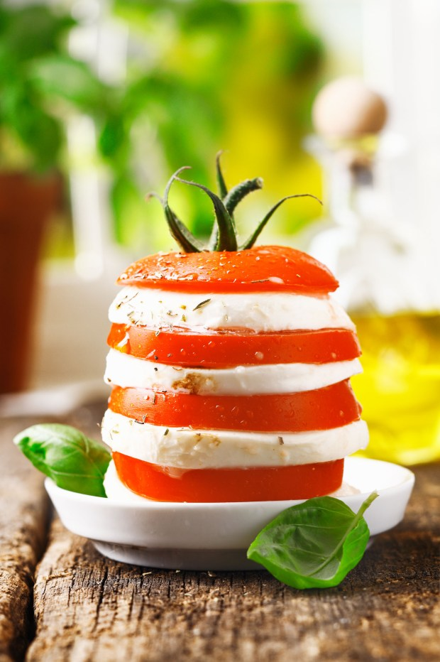 Stacking tomato and mozzarella like this offers a new approach to Caprese salad.