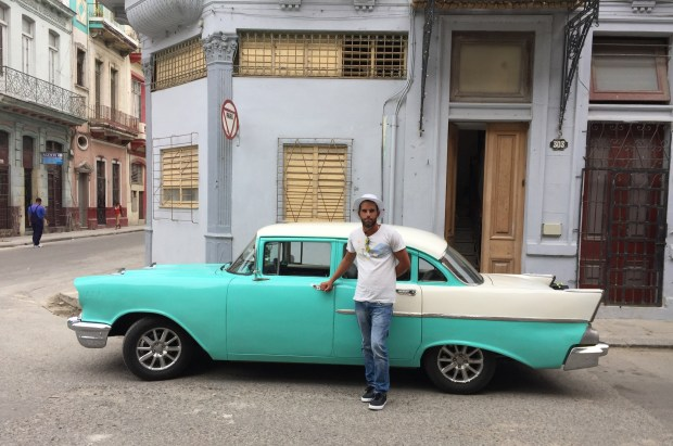 Alejandro poses in front of his turquoise 1957 Chevy Bel Air car after the cabdriver took us from Jose Marti International Airport to our Airbnb in central Havana in April 2017. (Courtesy of Jackie Gaston)