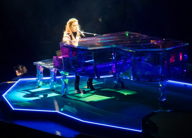Pop star Lady Gaga behind the piano at St. Paul's Xcel Energy Center on Monday, Aug. 21.