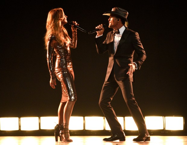 "Faith Hill, left, and Tim McGraw perform ""Speak To A Girl"" at the 52nd annual Academy of Country Music Awards in Las Vegas. The two perform again Saturday evening at St. Paul's Xcel Energy Center (Photo by Chris Pizzello/Invision/AP, File)"