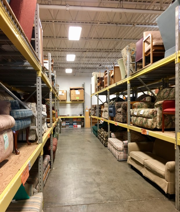"""Bridging is a nonprofit which provides furniture for families transitioning out of homelessness or poverty. Customers """"shop"""" the aisles to pick out the furnishings they need for their homes. (S. M. Chavey / Pioneer Press)"""