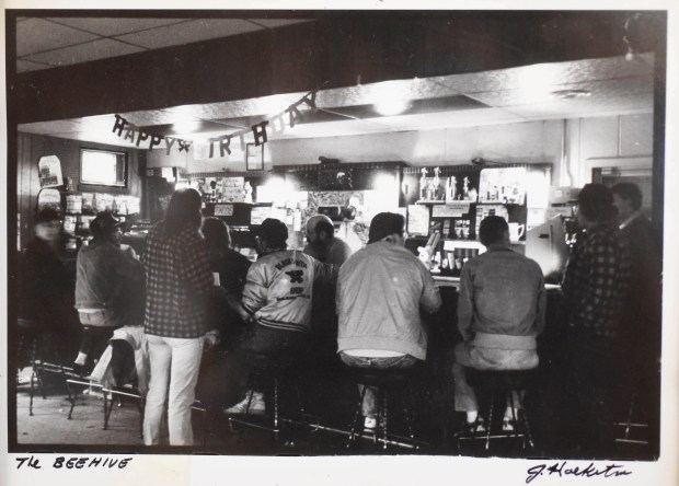 "An old photo of the Beehive Tavern from ""back in the day, probably the '80s"" when every bar stool was taken, with owner John Weber's younger brother Don behind the bar, is displayed at the bar in St. Paul on Aug. 9, 2017. The Beehive is one of the last 3.2 beer bars in St. Paul, and Weber, 75, plans to shut it down and sell the property. ""There is no money in it any more."" (Pioneer Press: Scott Takushi)"