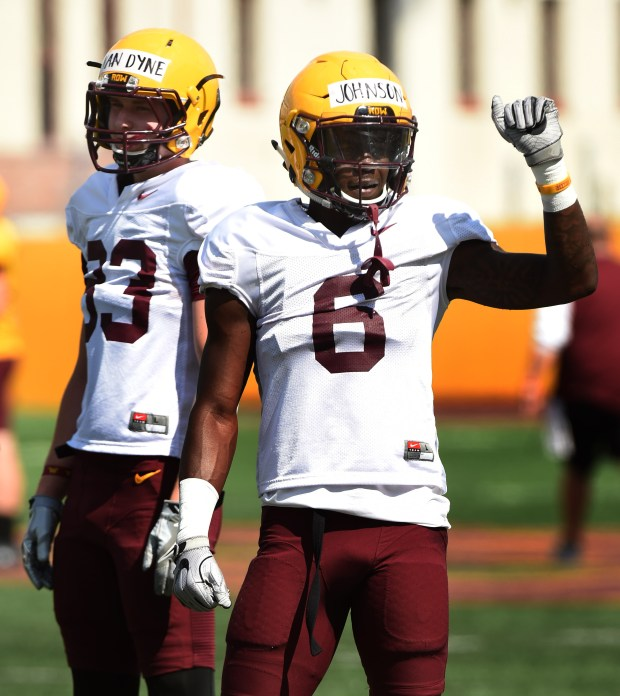 Wide receivers Harry Van Dyne, left, and Tyler Johnson pay attention during a Gophers football practice at the University of Minnesota, August 8, 2017. (Scott Takushi / Pioneer Press)