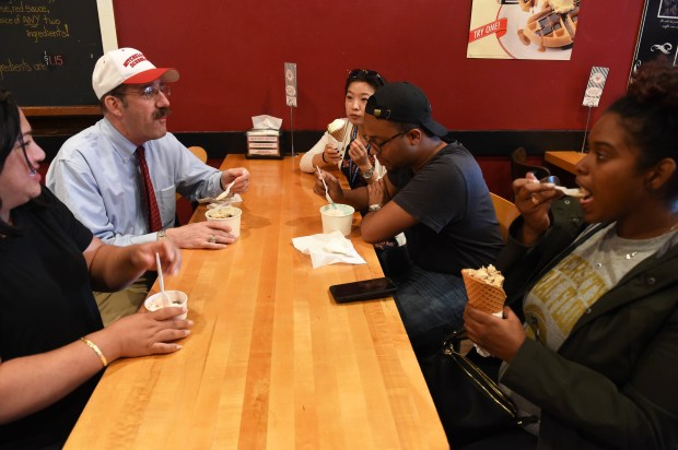 Mark Gordon, Dean of the Mitchell Hamline School of Law takes some of his students out for ice cream at Grand Ole Creamery in St. Paul,  August 10, 2017. From left: Ava Cavaco, Dean Gordon, Nou Her, Aaron Robinson, Kimberly Haynes. (Scott Takushi / Pioneer Press)