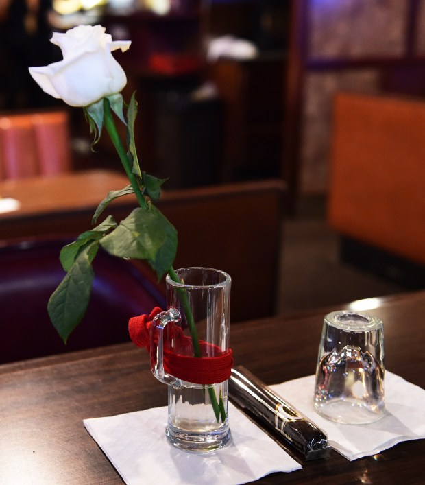 """A white rose, an Onyx cigar and an overturned shot glass mark """"Grandpa's Place"""", the spot at the bar always occupied by Earl """"Red"""" Schoenheider -- a place no one else is allowed to sit -- at Red's Savoy Pizza in St. Paul, August 29, 2017. Just a week after the passing of its founder, Earl """"Red"""" Schoenheider, his children have decided to close the original Red's Savoy location on East Seventh Street.The 421 E. Seventh St. building, which the family does not own, is not ADA compliant, and has some major structural issues that need to be fixed, said company spokesman Reed Daniels. (Scott Takushi / Pioneer Press)"""