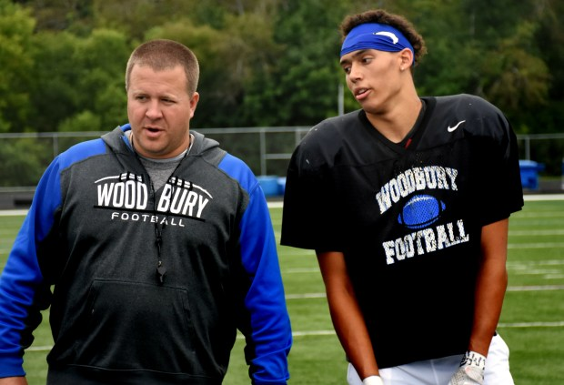 Woodbury defensive end David Alston, right, chats with head coach Andy Hill during practice on Aug. 19, 2017 at Woodbury High School. Alston is the highest rated prospect in the state, according to Rivals, yet he doesn't have an offer from the Gophers. (Dane Mizutani / Pioneer Press)