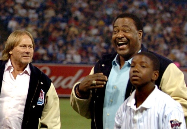 Don Baylor, back right, laughs as Dan Gladden, left, looks on during the 20- year reunion of the 1987 World Series champion Minnesota Twins team at the Metrodome in Minneapolis on August 18, 2007. (Sherri LaRose-Chiglo / Pioneer Press)