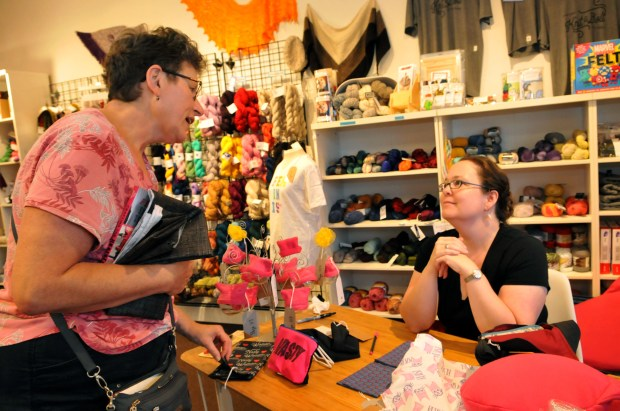 Cammy Johnson of Maplewood chats with local author and craftivist, Lara Neel, who has helped spawn a movement of craftivisim or the making of crafts that protest something. Neel was at Knit and Bolt in NE Minneapolis signing copies of her new book, 'Crafting the Resistance', on Friday, August 25, 2017. (Ginger Pinson / Pioneer Press)