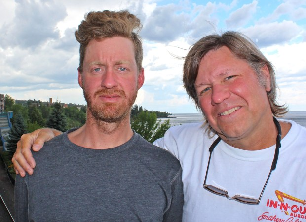 Daniel O'Kane (left) of St. Paul and Paul Voge of Duluth paused along Duluth's waterfront after O'Kane had swum to 19 of 22 Apostle Islands in 18 days starting July 16. Voge accompanied him in a kayak for safety purposes and to transport gear and food. Sam Cook / Forum News Service