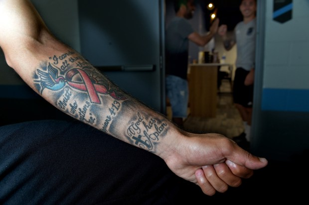 Minnesota United midfielder Miguel Ibarra's left forearm ink includes a pink ribbon commemorating breast cancer awareness, a cause close to him after impacting many friends. It's surrounded by birds and Bible verses meaningful to him. (Jean Pieri / Pioneer Press)