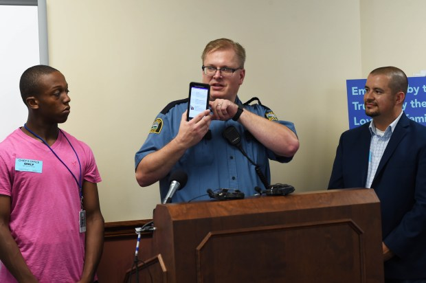 From left: Devonte Ray-Burns, 14, of St. Paul, an autistic teen who wears a VITALS beacon, St. Paul Police Officer Rob Zink who was instrumental in putting the program into use, and Nick Tietz, Chief Digital Officer for Varia-Ware, the company which manufactures VITALS. From the Autism Society of Minnesota website: A new technology-based project called the 'Vulnerable Individuals Technology Assisted Location Service' - or VITALS - helps make the invisible visible. VITALS uses a transmitter, or beacon, and a mobile app that allow individuals with an 'invisible' disability to voluntarily disclose their diagnosis to emergency responders within a 30-50 foot radius. (Scott Takushi / Pioneer Press)